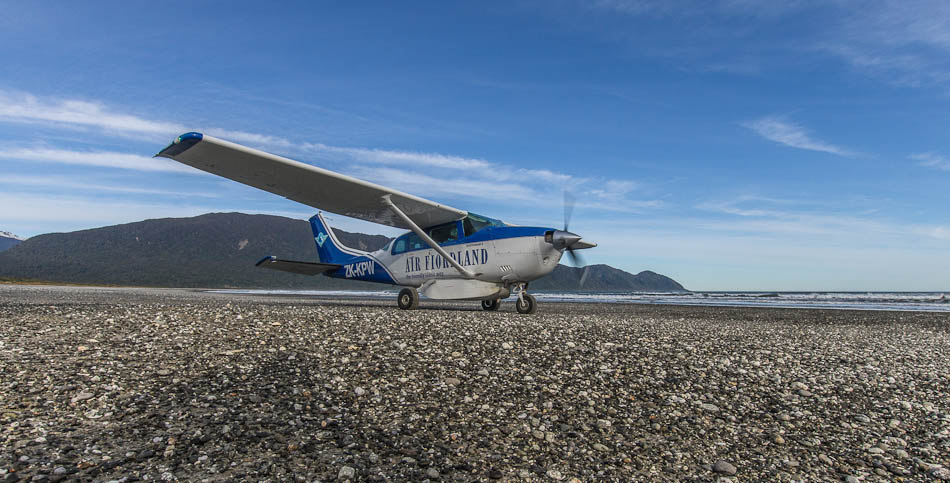 Cessna Stationair in Big Bay, Fiordland, New Zealand.