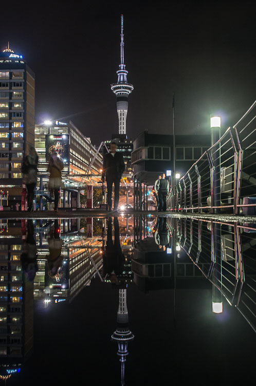Reflection of Sky Tower at night, Auckland, New Zealand