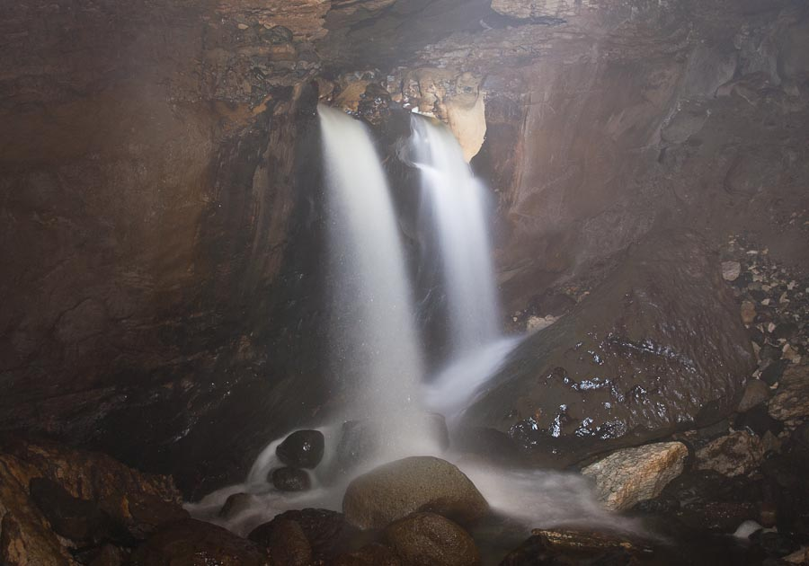 Waterfall in Aurora Cave, Murchison Mountains, New Zealand