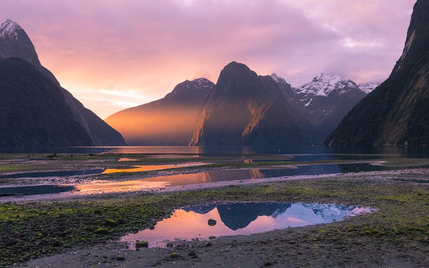 Sunset over Milford Sound & the last sunbeam, Fiordland, New Zealand