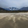 Flying sand, Big Bay, Fiordland, New Zealand | photography